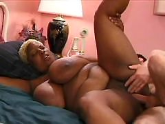 Ebony licks off cum from huge bust